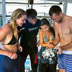 Divemasters socialise and advise their scuba divers in Thailand