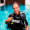 An Open Water Diver student ready for her pool lesson in Chalong