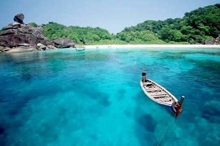 Long-tail boat at Donald Duck Bay, Similan Island no. 8 - photo courtesy of Tourist Authority of Thailand