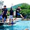 Giant stride boat entry at Racha Yai during the Open Water Diver course