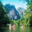 Day trippers from Khao Lak enjoy a rafting expedition in Khao Sok National Park