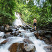 Visiting a waterfall in Khao Lak, Thailand