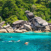 Tourists snorkel in the Similan Islands National Park